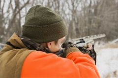 Man aiming shotgun. Royalty Free Stock Images