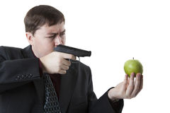 Man aims at the apple on his hand Stock Images