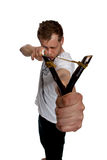 A man aims a slingshot. Young man aiming a slingshot poses in the studio on a white background Royalty Free Stock Photography