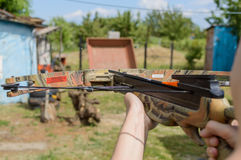Man aims at target by crossbow or arbalest. Royalty Free Stock Image