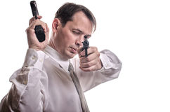 The man aims from the weapon. The man in a white shirt aims from the weapon Royalty Free Stock Image
