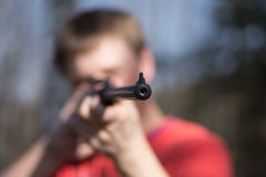 Man with air gun in forest Royalty Free Stock Images
