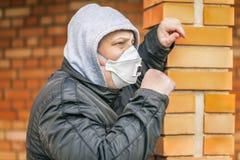 Man in the air mask at the brick wall Royalty Free Stock Image