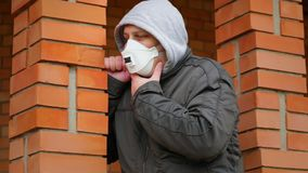Man in the air mask near building stock footage