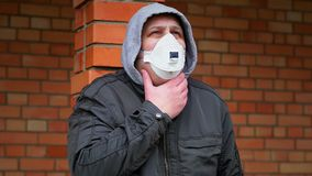 Man in the air mask at outdoors near building stock video footage