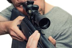 Man with air rifle, with mounted sight royalty free stock photo