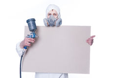Man with airbrush gun and blank Royalty Free Stock Image