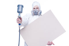 Man with airbrush gun and blank Royalty Free Stock Photography