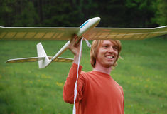 Man with aircraft model Royalty Free Stock Photography