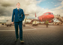 Man in aircraft uniform on airport area Royalty Free Stock Photos