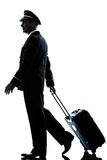 Man in airline pilot uniform silhouette Stock Photography