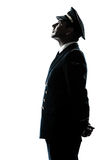 Man in airline pilot uniform silhouette Stock Photo