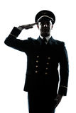 Man in airline pilot uniform silhouette saluting. One caucasian man in airline pilot uniform saluting silhouette  in studio isolated on white background Royalty Free Stock Photography