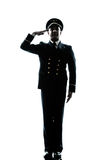 Man in airline pilot uniform silhouette saluting. One caucasian man in airline pilot uniform saluting silhouette  in studio isolated on white background Royalty Free Stock Photos
