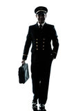 Man in airline pilot uniform silhouette walking Royalty Free Stock Photos
