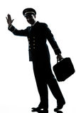 Man in airline pilot uniform silhouette walking Stock Photography