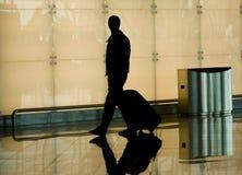 Man at the airport. Man rushing through an airport terminal royalty free stock photo