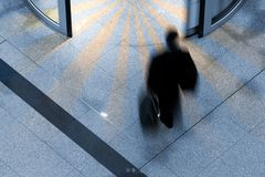 Man at an airport. Man rushing through an airport terminal Stock Image