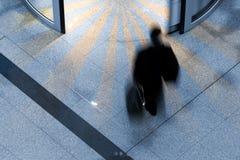 Man at an airport. Man rushing through an airport terminal stock image
