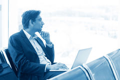 Man at airport lounge Royalty Free Stock Images