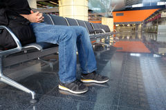 Man in airport lounge sitting on chair royalty free stock photos