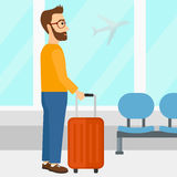 Man at airport with suitcase. Stock Photo