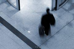 Man on airport terminal. Man rushing through an airport terminal stock images