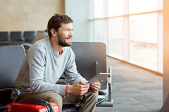 Man in airport Stock Photography