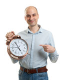 Man with an alarm clock Royalty Free Stock Photo