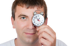 Man with an alarm clock Stock Images