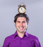 Man with alarm clock Stock Image