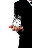 Man with alarm clock on his palm Stock Photo