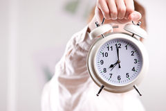Man with Alarm Clock over Face Royalty Free Stock Photos