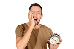 Man with alarm clock. Royalty Free Stock Photography
