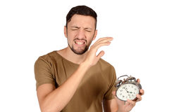 Man with alarm clock. Royalty Free Stock Photos