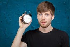 Man with alarm clock Stock Photos