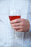 Man & Alcohol. The man holds a wine glass Royalty Free Stock Photography
