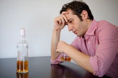 Man alcohol abuse. Man feeling bad because of alcohol abuse royalty free stock photos