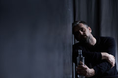 Man with alcohol bottle Royalty Free Stock Photos