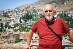 Man at the Alhambra in Cordoba, Spain. A senior man enjoys exploring the Alhambra in Cordoba, Spain with the city in the background Stock Photos