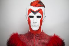 Man Alien red white face stock photography