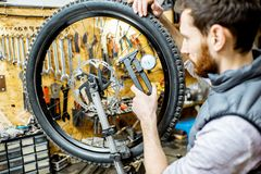 Man aligning a bicycle wheel stock photos