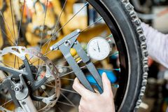 Man aligning a bicycle wheel stock photography