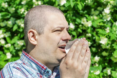 Man with allergy sneezes Stock Photos