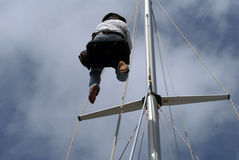 Man aloft and blue sky Royalty Free Stock Image