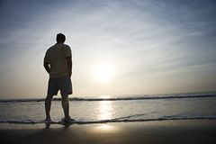 Man alone on beach. Stock Images