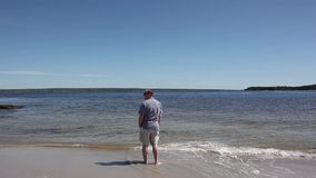 Man alone on beach stock video footage
