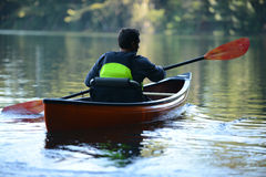 Man alone on a beautiful lake on a kayak Royalty Free Stock Photos