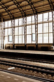 A man alone at the empty train station with stained big window b Stock Photo