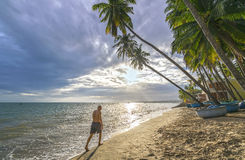 The man alone go to the end of tropical beach Stock Image
